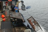 A crab pot is launched