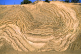 Rocks are highly distorted by movement along the San Andreas strike slip fault near Palmdale, CA