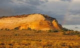 Cliff of Navajo Sandstone and rainbow, White Pocket, Vermilion Cliffs National Monument, AZ