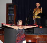 Leah of KZFR makes a final appeal for raffle tickets, while Joe Craven picthes from the stage