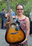 KZFR volunteer Debbe shows off the guitar for raffle