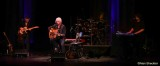 Arlo Guthrie and the band: Abe Guthrie on keyboards, Bobby Sweet on guitar, and drummer Terry A La Berry