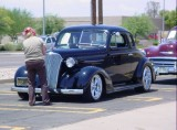 Kay inspecting the 1937 Chevy Coupe