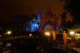 Haunted mansion at night in the rain