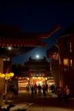 Moon rising through China streets