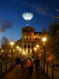 Balloon rising at night over Disney Springs