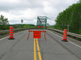 The bridge is closed because the flooding of the river!