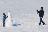 Dad taking a picture of me and my Snowman on Collingwood Harbour - Mar. 7, 2014