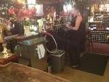 Barmaid Pulls a pint in the Nobody Inn.