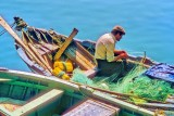 Fisherman Mending the Nets