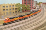 Roaring past Norwalk with grain cars in tow.