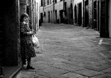 Lonely woman in an empty street