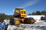 Tucker Sno-Cat up on the ramp truck with a broken rear axle