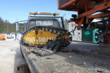 Tucker Sno-Cat axle under repair