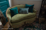 025 - moss chenille settee at exterior wall in Client Area - staying