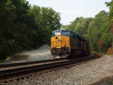 3088 passes by pulling freight