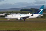 Westjet Boeing 737-7CT lands at Glasgow