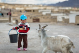 Young girl and goat - Tajikistan