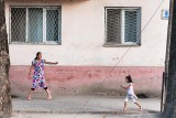 Girls walking in street - Tajikistan