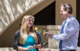 Kate Gomolak receives a rose from  Dr. Bill Walker
