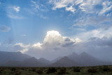 Strange day - winds blowing dust, creating unusual clouds and light, in advance of rain storms scattered all over the region