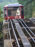 Tram dissappears over the steep incline