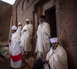 Priests in front of ancient churches in Lalibela