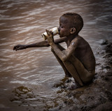 Dassanech Child Drinking from the Omo River