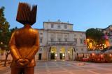 Fernando Pessoa statue and S. Carlos National Theater