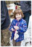 Norah holding a bird in a bag
