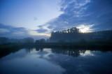 Water Meets The Sky In Misty Twilight
