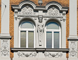 Caryatid Between The Windows