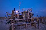 March : Moonset over Chatham driftwood house