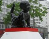 Child-lizard sculpture