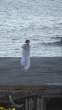 Tai Chi on Es Calo Harbour……a daily ritual for this lady