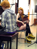 Charlotte (singing) and Kyle (on piano)