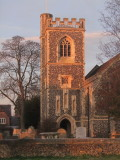 Early  sunlight  illuminates  the  church  tower,