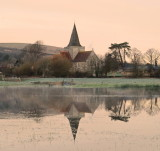 C. 14th century St. Andrew's  Parish  Church , reflecting  in  recent  floodwaters.