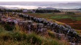 On  Peel  Crags  looking  to  the  misty Tyne  Valley.