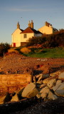 Old  coastguard  cottages  and  anti--erosion  barriers.