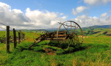 A  redundant ,rusting ,abandoned  piece  of  farming  machinery.