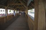 Sur le pont couvert Kapellbrücke