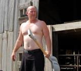 farmer son working ranch shoveling.jpg
