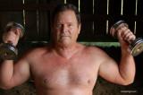 big hunky rancher lifting weights working.jpg