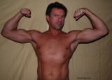 cajun daddies flexing muscular arms.jpg