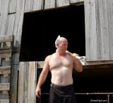 candid men working hard ranchers.jpg