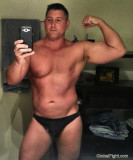 musclehunk flexing big muscles.jpg