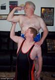 ginger feeling his daddies big muscles arm.jpg