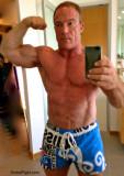 big stocky irish bloke flexing biceps.jpg