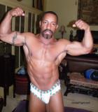 black musclestud flexed arms.jpg